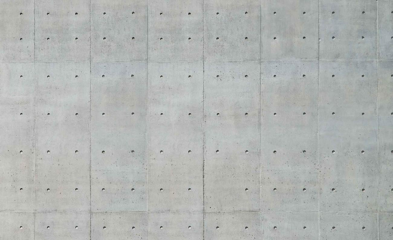 Carta da parati muro cemento bucato for Carta da parati effetto muro