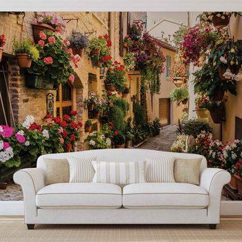 Śródziemnomorska uliczka pełna kwiatów Fototapeta
