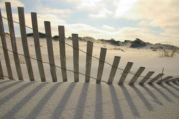 Glasschilderij Fence on the Beach