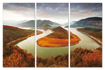 Obraz  Tekoucí řeka kolem skály