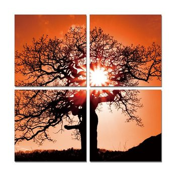 Silhouette of a tree in a red sun Schilderij