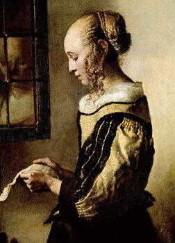 Vászonkép Girl at a window reading a letter