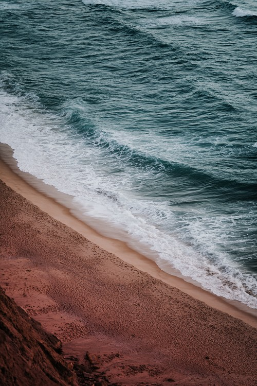 Exklusiva konstfoton Empty red beach at sunset