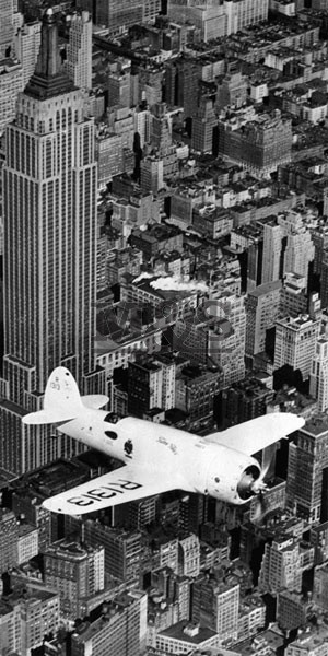 Poster Hawks airplane in flight over New York city 1937